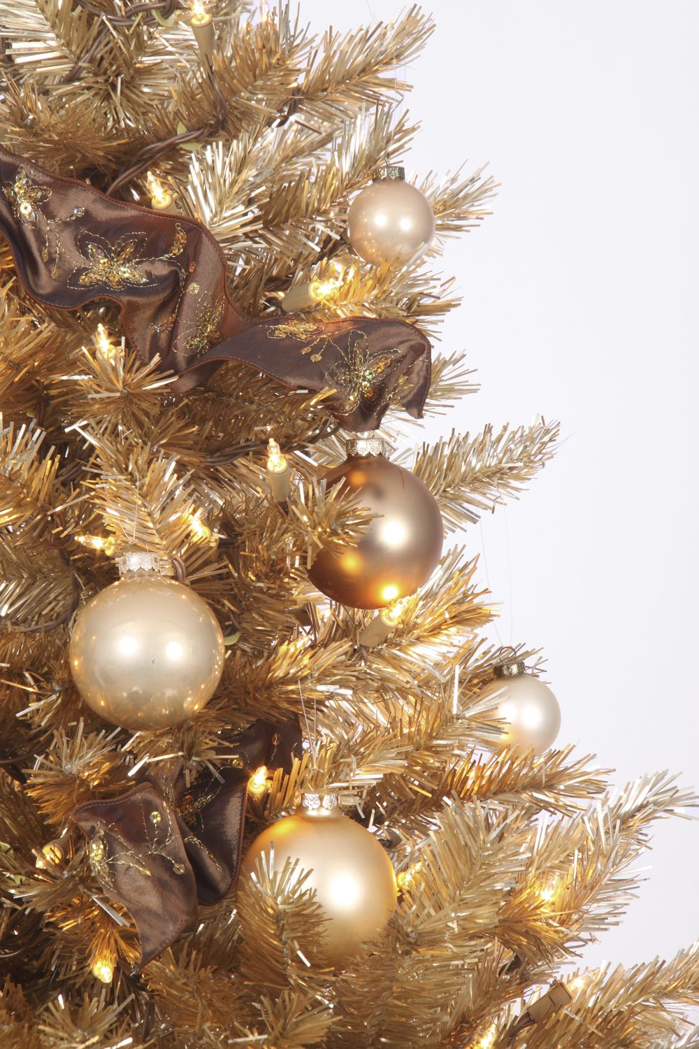 The Toasted Champagne Gold Christmas Tree Features Tips And Needles Fully Hinged Branches That