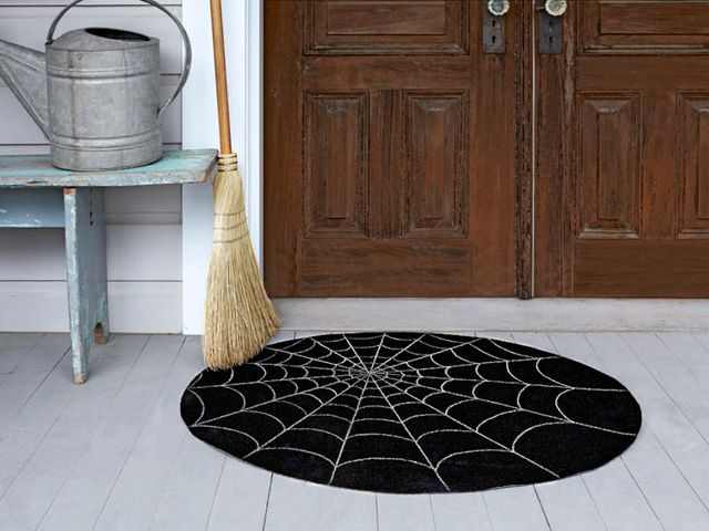 Spiderweb doormat. 52 Halloween Craft Ideas for Kids - Halloween DIY Craft Projects - Country Living. http://www.countryliving.com/crafts/projects/best-halloween-crafts-ever#slide-17