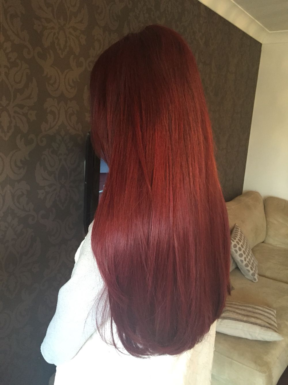 A Full Head Of Bright Red Micro Bond Hair Extensions