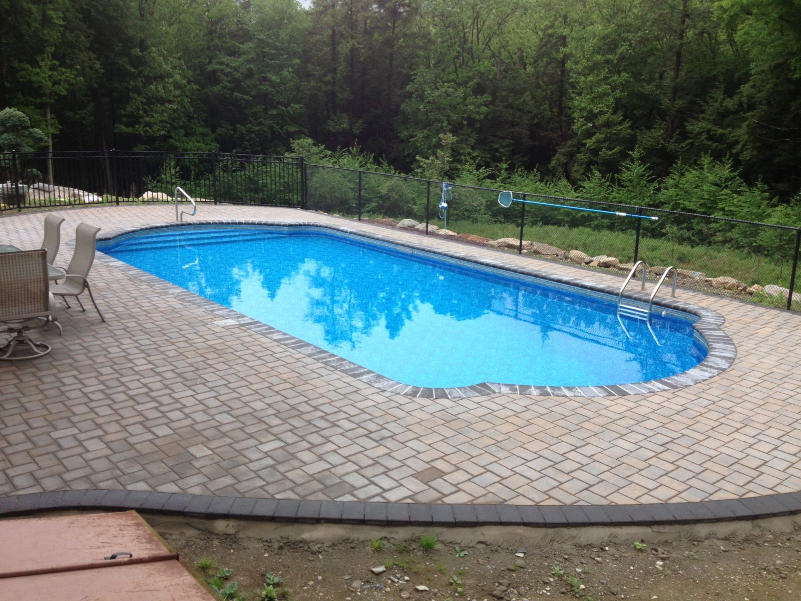 Double roman end shaped vinyl lined steel in-ground pool