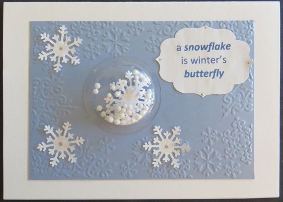 This is a handmade shaker card with a sentiment stamped on the front of card a snowflake is winters butterfly and the inside of the card is blank.