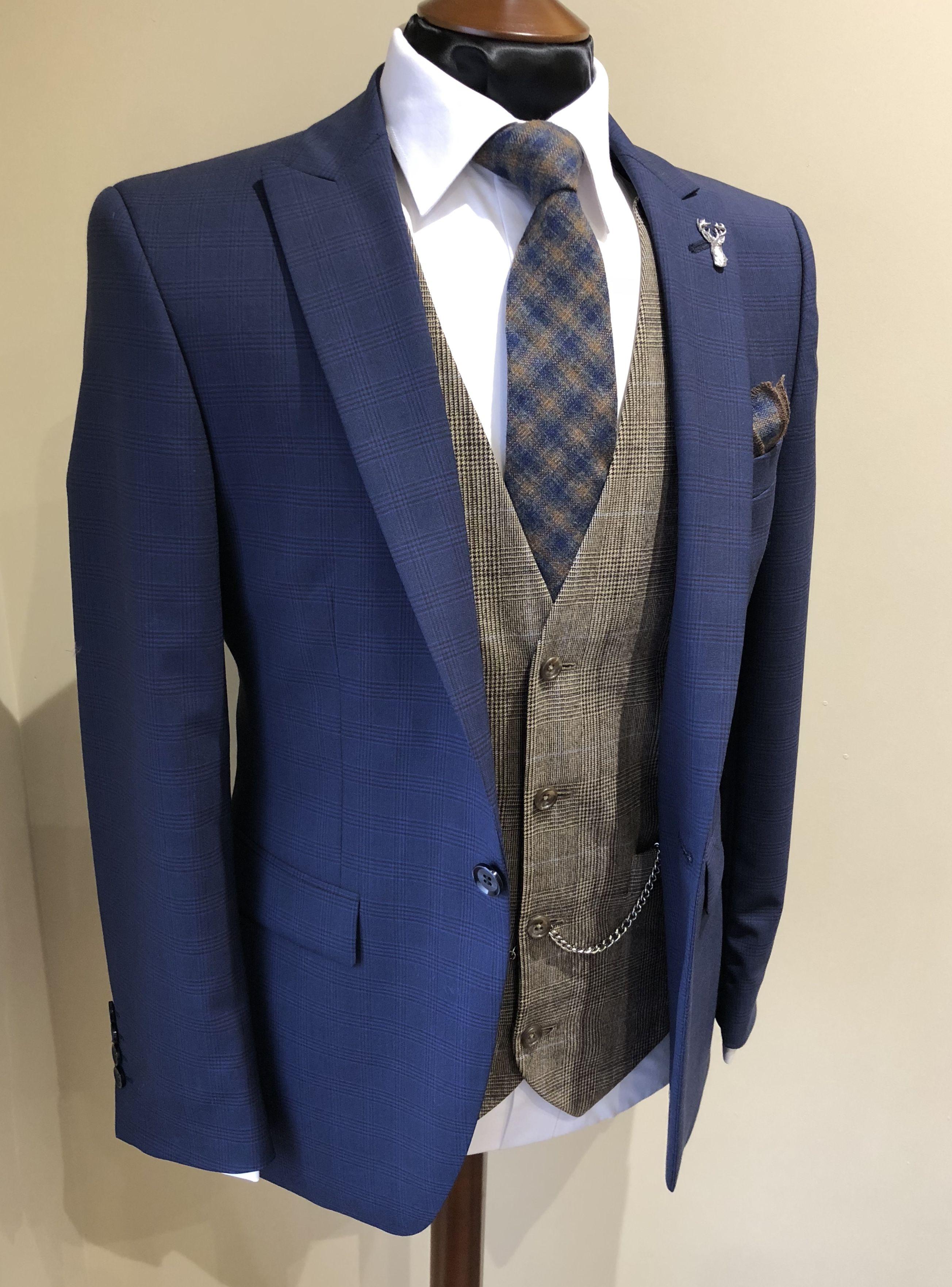 Country wedding inspo brown tweed waistcoat groom