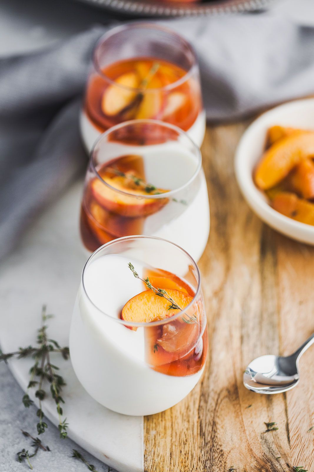 Vanilla Yoghurt Panna Cotta With Balsamic Thyme Roasted Peaches And Nectarines •Olive & Mango