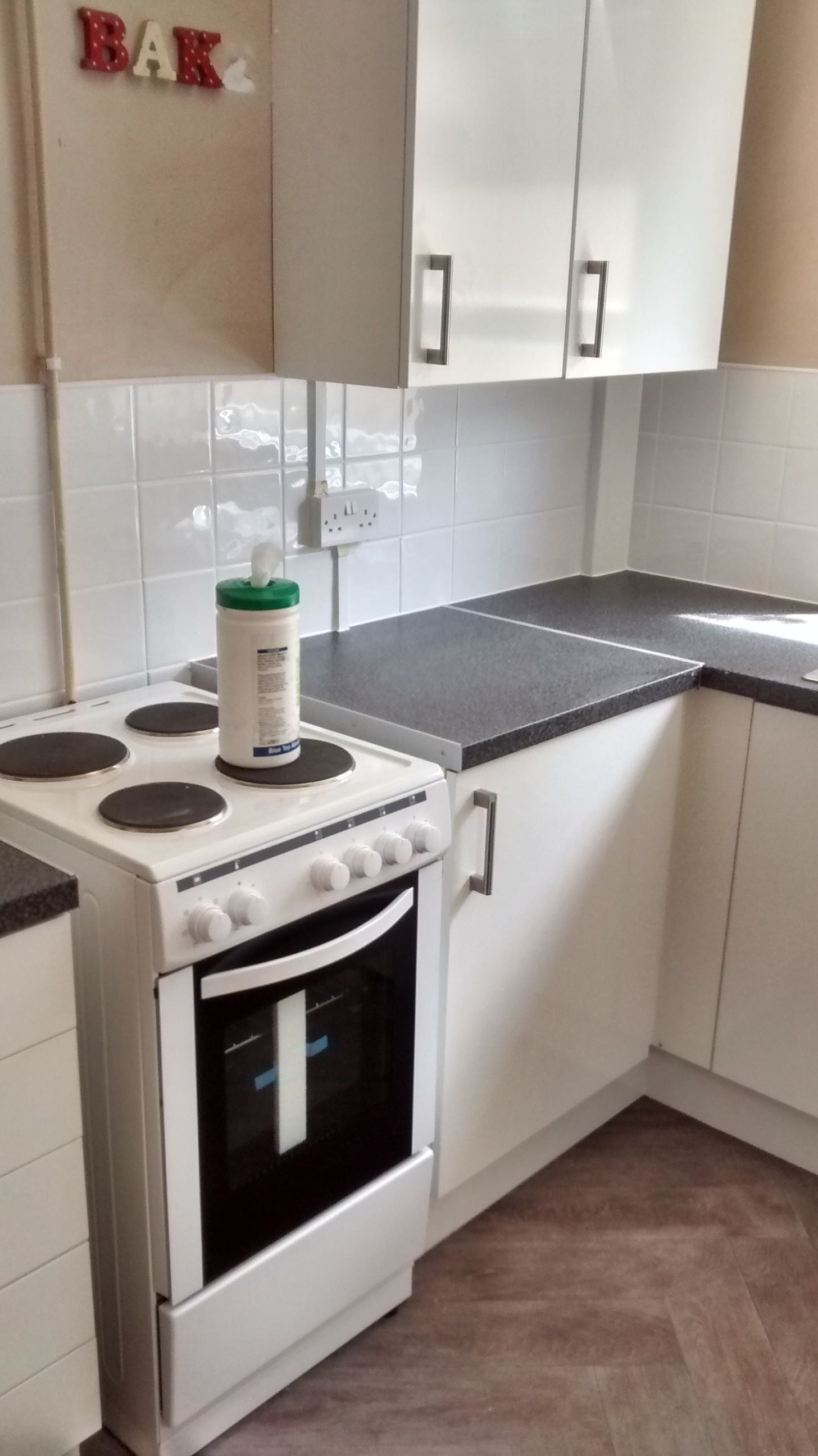 Dakota worktop with High Gloss White cupboards Stainless Steel