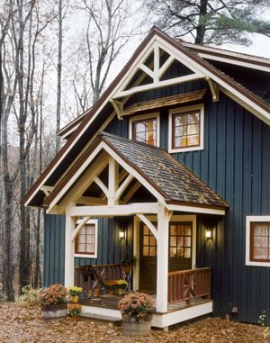 Note the bronze colored roof looking great with the navy for Cottage exterior siding ideas