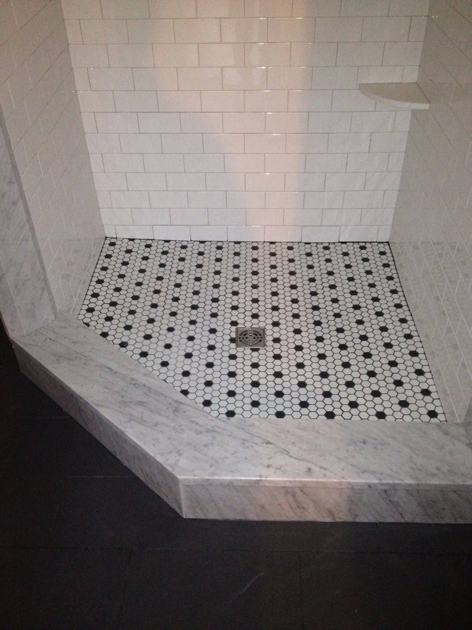 Tiling Bathroom Door Threshold small bathroom takes on a classic white hex tile floor with