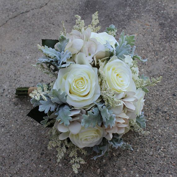 White cream color bouquet used silk flower rose dusty miller used silk flower rose dusty miller hydrangea and greenery natural color ribbon on the handle bouquet size is approx 9 wide 11 tall mightylinksfo