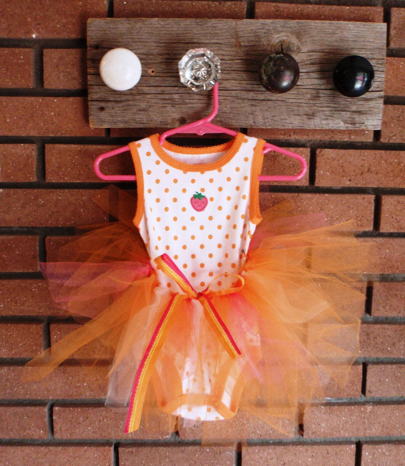 orange and white polka dot tank onesie with by graceunraveled, $10.00