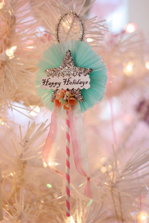 love the simple and nostalgic feel of this ornament. . . . Elmers glue, glitter, chipboard or card board star, crape-papper (streamers), ribbon, food skewer, silver chenille stem, printed or stamped greeting cut out & embellishment of choice; layered as seen and voila! At least that's how I do it. ;o) heehee