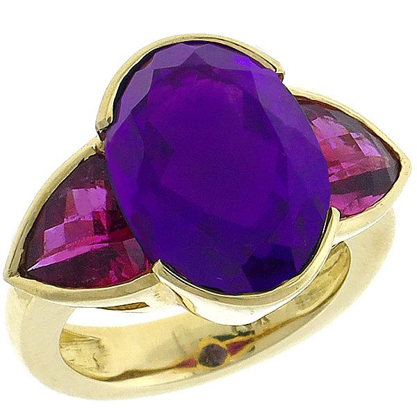 This is a fabulous amethyst pink tourmaline 14k yellow gold ring. The ring is set with oval cut amethyst and shield shape checker board faceted pink tourmaline that weighs 15.00ct and 4.00ct respectively.