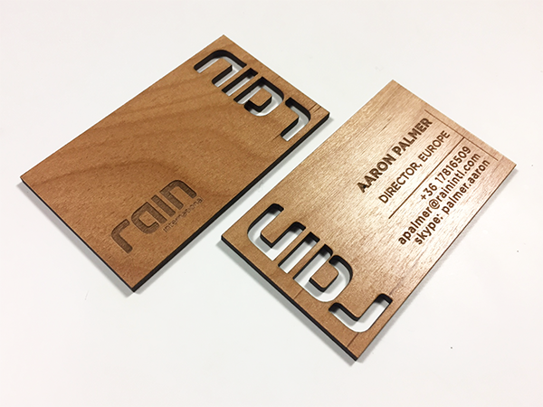 Logo Cut Out Of A Wood Business Card