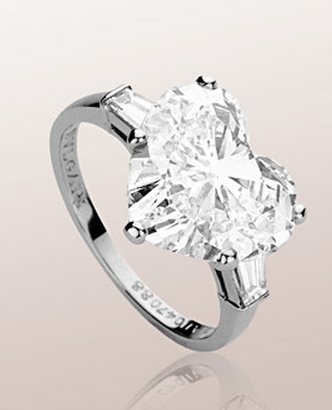 bulgari griffe solitaire ring in platinum with heart cut diamond and 2 side diamondsa classic setting that allows the beauty and the pureness of the