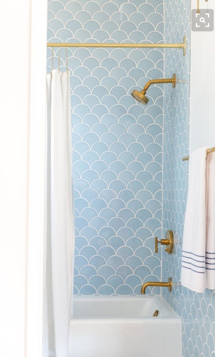 Blue tile and gold fixtures make for modern and classic bathroom ...