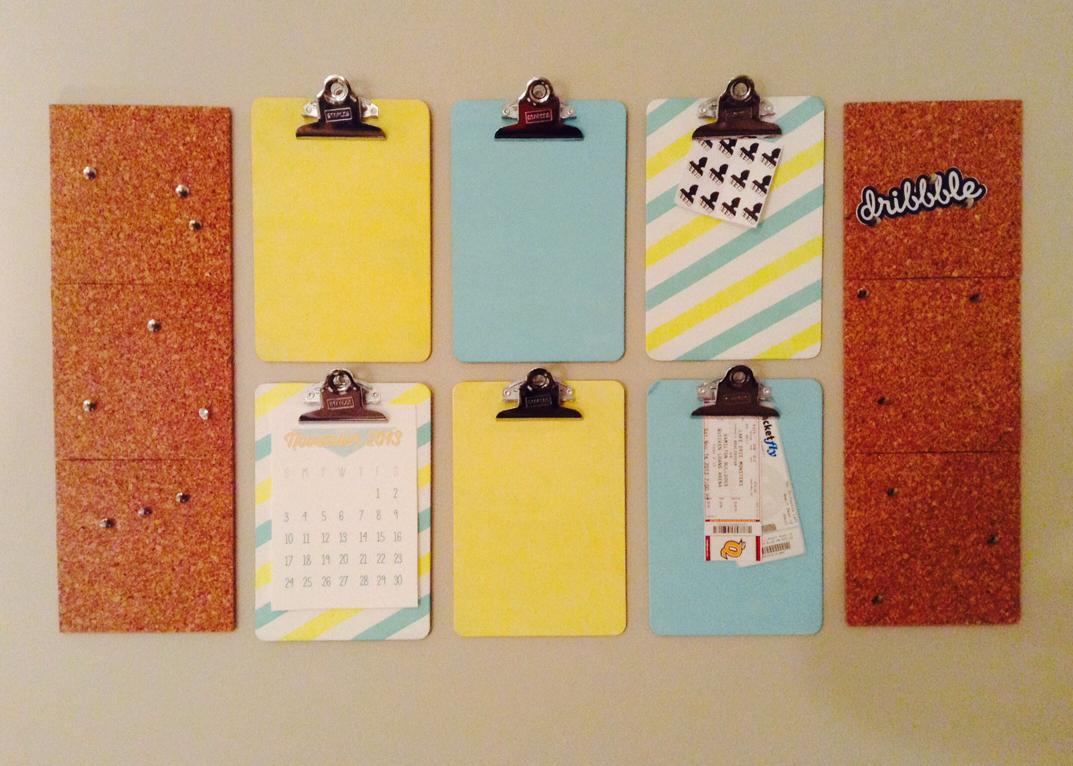 Office wall organization with mounted clipboards and cork board ...