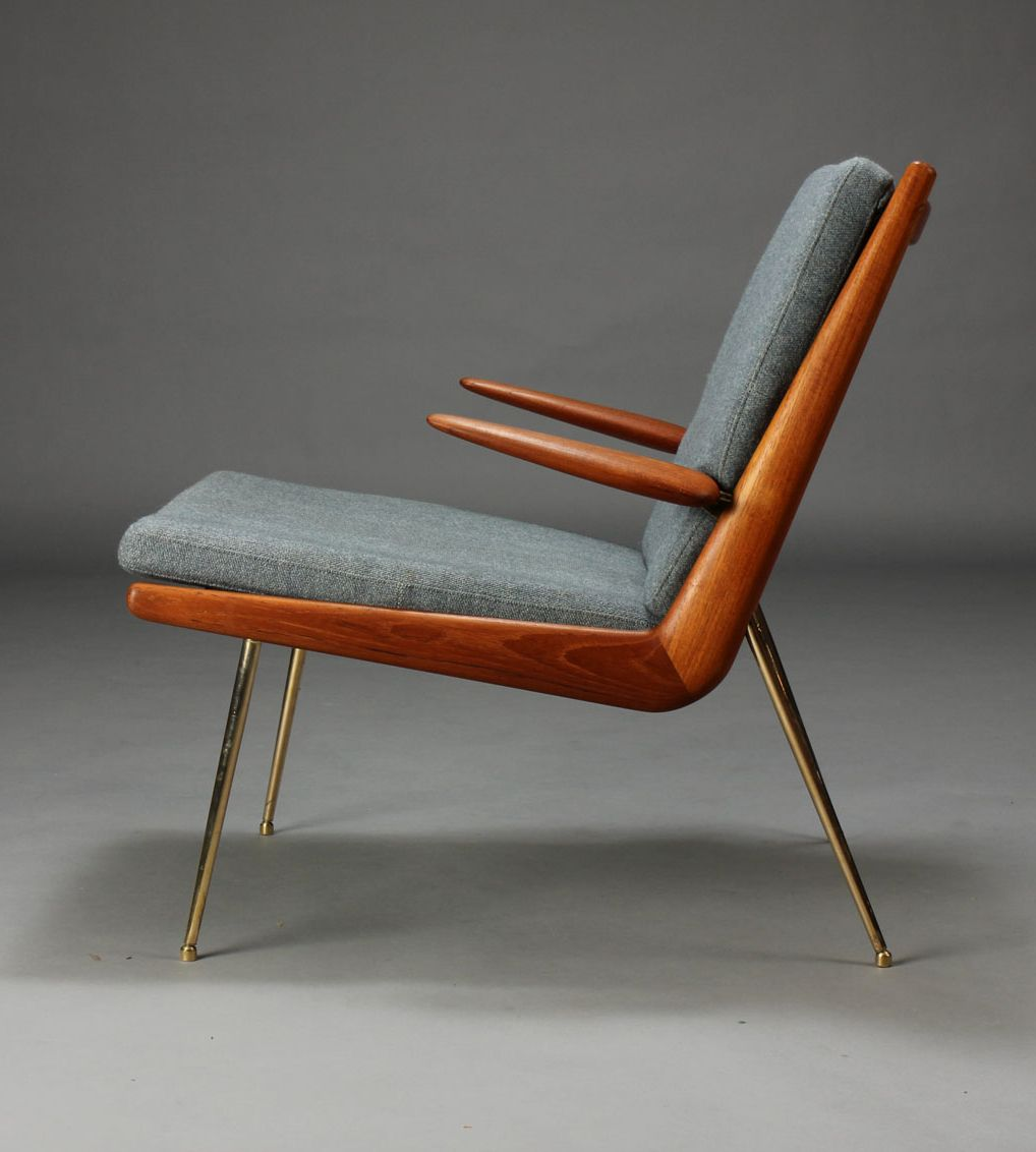 Peter Hvidt & Orla Mølgaard-Nielsen. Boomerang Chair. Lounge chair with solid teak frame, loose cushions upholstered in bluish wool, chromed brass legs. Designed in 1956. Produced by France & Søn