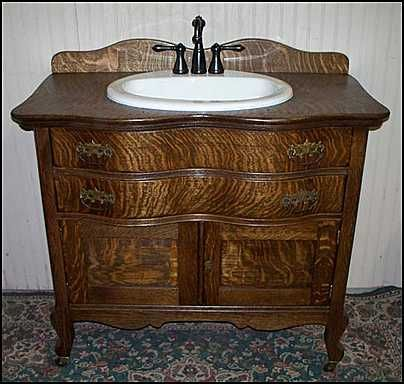 Photo of Front View - Antique Bathroom Vanity: Antique Oak Washstand with  sink and bronze faucet - Photo Of Front View - Antique Bathroom Vanity: Antique Oak Washstand