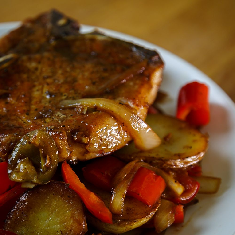 Delicious Pork Chops With Potatoes, Onions, Bell And