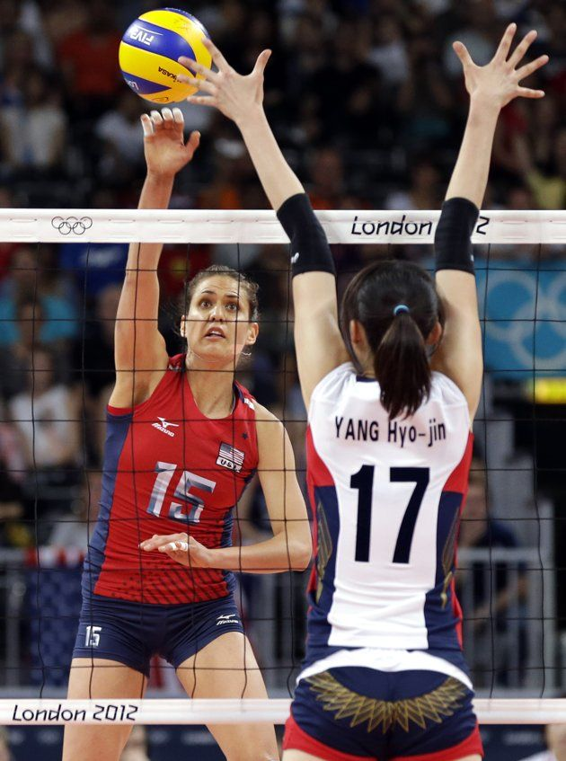 Usa S Logan Tom 15 Spikes The Ball At South Korea S Yang Hyo Jin 17 During A Women S Volleyba Women Volleyball Female Volleyball Players Olympic Volleyball