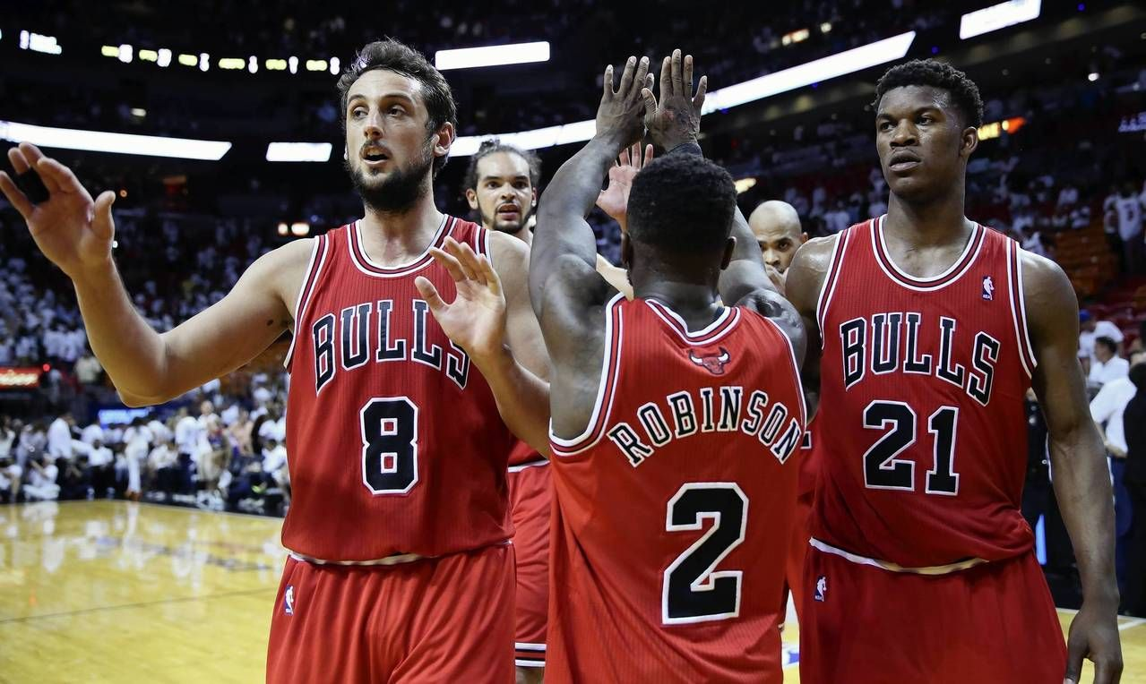 Marco Belinelli (8) and Jimmy Butler (21) highfive Nate