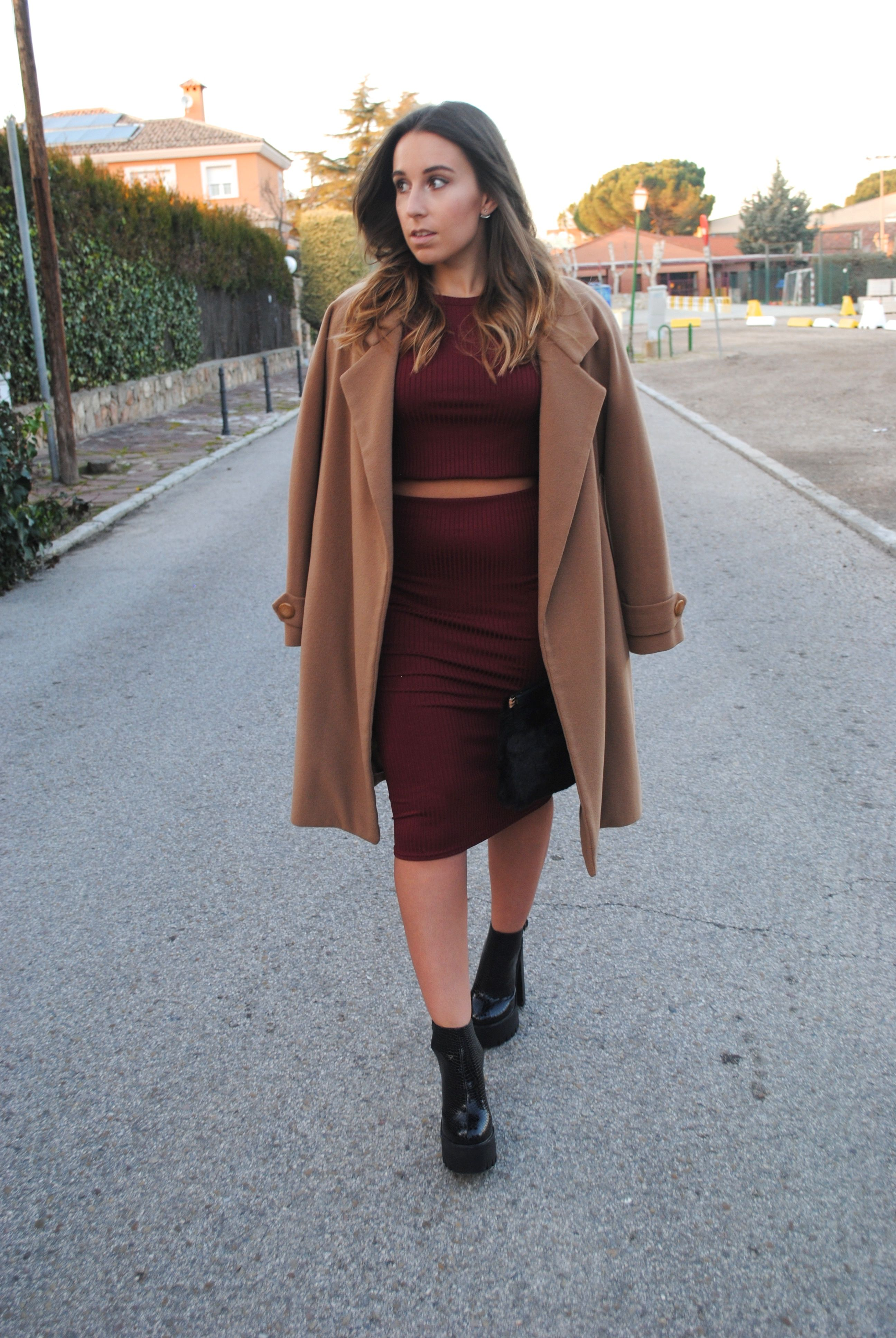 Go for a sophisticated look in a tan coat and a dark red