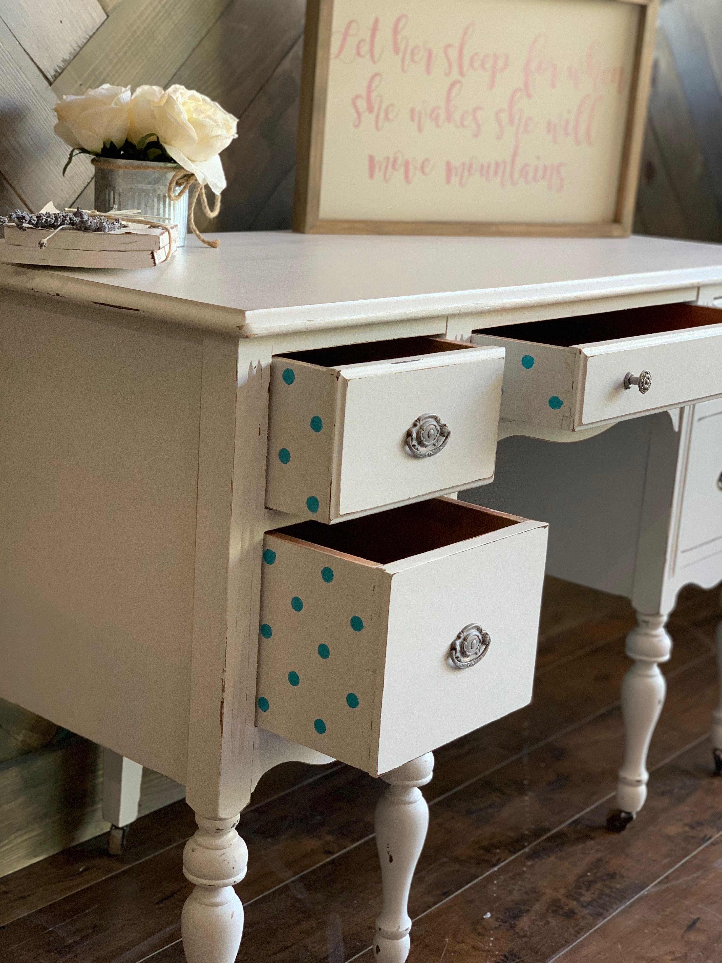 Redesign with Prima Stick and Style Mini Dot on the interior drawers painted with Pure Ocean. Desk painted in Dixie Belle Fluff, distressed and sealed in Satin. #redesignwithprima #dixiebellepaint #dixiebellepaintcompany #dixiebellepaintcompany #furnituremakeover #upcycledfurniture #diyfurnitureupcycle #farmhousestyle #farmhousedecorideas #vintagefurniture #vintagefurnituremakeover #furnitureartist #vintagefurnituremakeover #farmhousechic #boutiqueshopping