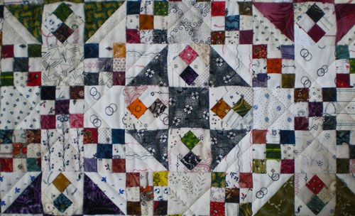"""A close-up of the Ohmigosh! quilt blocks    The nine patches that create the chains are 1-1/2"""" finished, as are the half square triangles. The little four patches on point are 1"""" finished."""