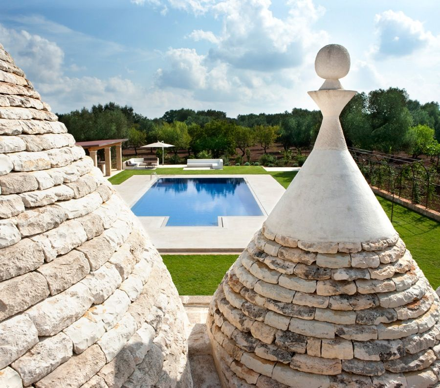 This is an ancient trullo in the heart of the Salento region, very close to Ostuni and Alberobello and minutes from the white shores of the Adriatic coast. The  main house is surrounded by 248,400 SqFt of pure beauty: the apulian countryside that fades onto the sea. The contemporary villa is surrounded by a typical maquis shrubland oasis with secular olive, almond, fig trees, plum and walnut trees. The swimming pool is entirely decorated with cobalt blue mosaics.