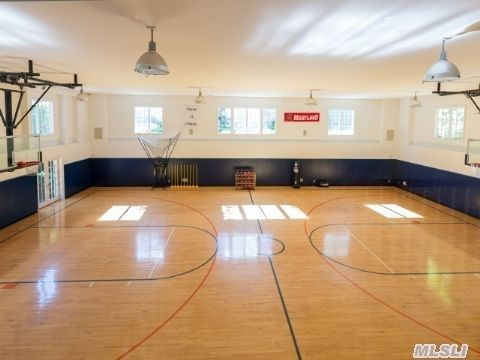 March Madness 16 Homes For Sale With Basketball Courts Home Basketball Court Basketball Court Indoor Basketball Court