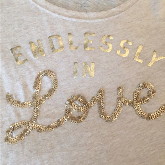American Eagle cream with gold writing shirt. Barely worn cream colored shirt with gold writing. Love is written in sequence. American Eagle Outfitters Tops