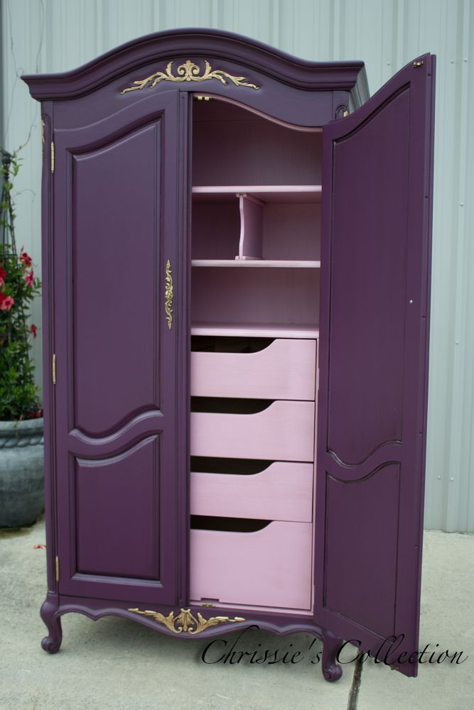 French Provincial armoire painted in a rich purple with a soft pink interior.