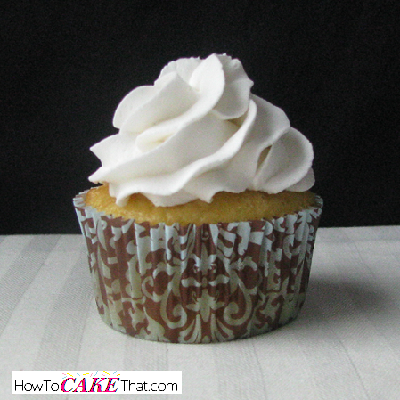 Easy recipe for pure snow white frosting. Complete photo tutorial on how to make it!