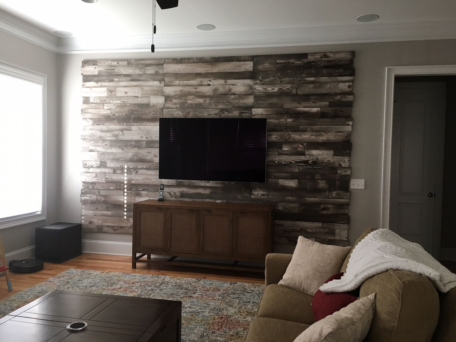 Customer in South Carolina just submitted this photo. Featured here is our Stonewash Grey Prefab Wall Panels. Nice design how she left the sheet rock wall on all four sides, kind of like a wood tapestry.