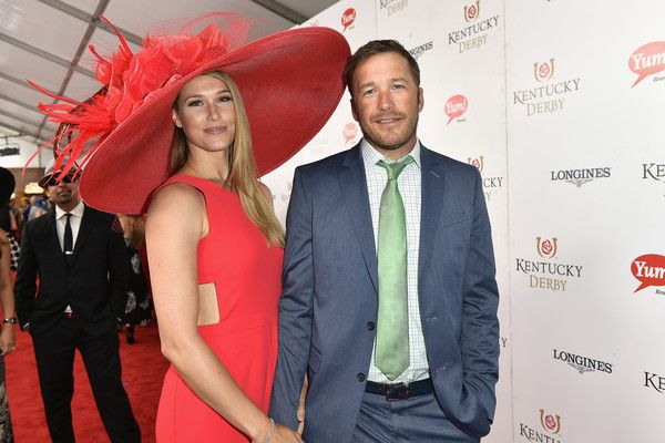 Volleyball player Morgan Beck and husband Olympic gold medalist, Bode Miller at the 2017 Kentucky Derby! I love her oversized red Derby hat and cutout dress. Learn how you can achieve this look with 20 of the best Kentucky Derby inspired hats. Photo credit: (May 5, 2017 - Source: Gustavo Caballero/Getty Images North America) Source: Zimbio