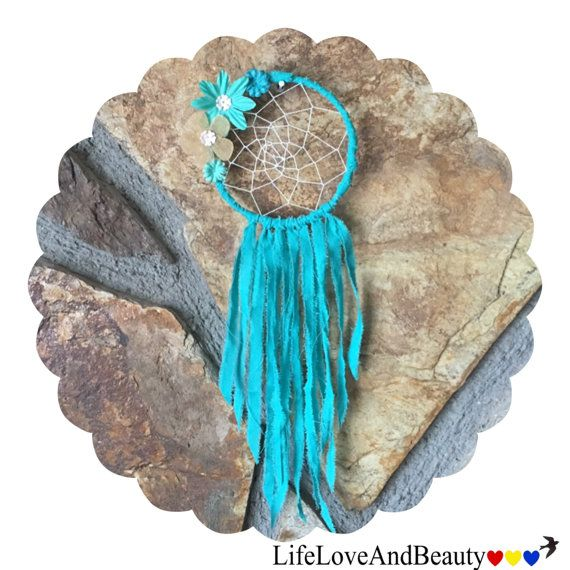 """Turquoise Teal Floral Dream Catcher. This beautiful dream catcher is smaller in size, handmade, unique and one of a kind. It is hand woven with and flower embellishments around a 3"""" durable metal wire hoop wrapped in turquoise fabric. A hand picked assortment of teal and gold flowers embellishments, and fabric ribbon create a simple, yet vintage look for this classic keepsake. You can hang this lovely dream catcher anywhere you desire!"""