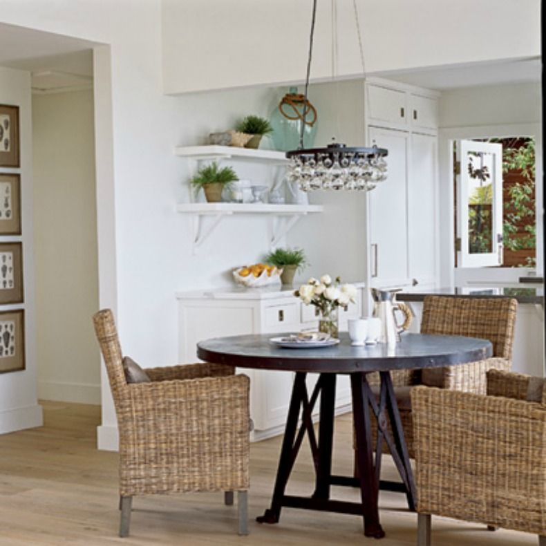 Rustic Beach Dining A Round Wooden Table And Stylish Rattan Chairs Add Interest To This Simple Laguna Area