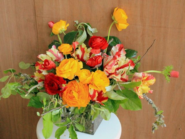 Ranunculus, anemones, parrot tulips create a fresh bouquet of spring time flowers.  Grown and arranged by Bare Mtn Farm