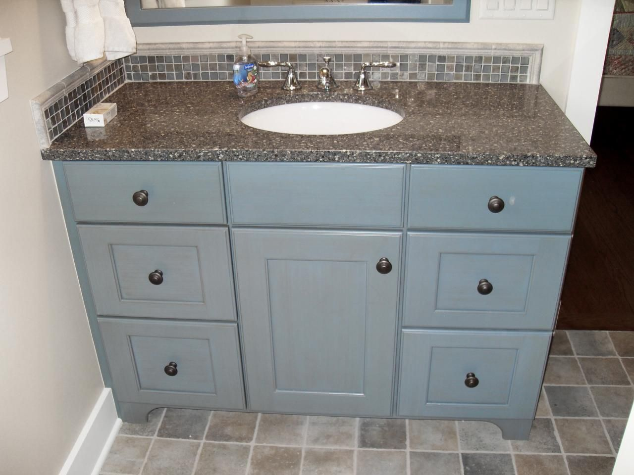 The soft gray-blue of the Shaker-style vanity draws its hue from the ...