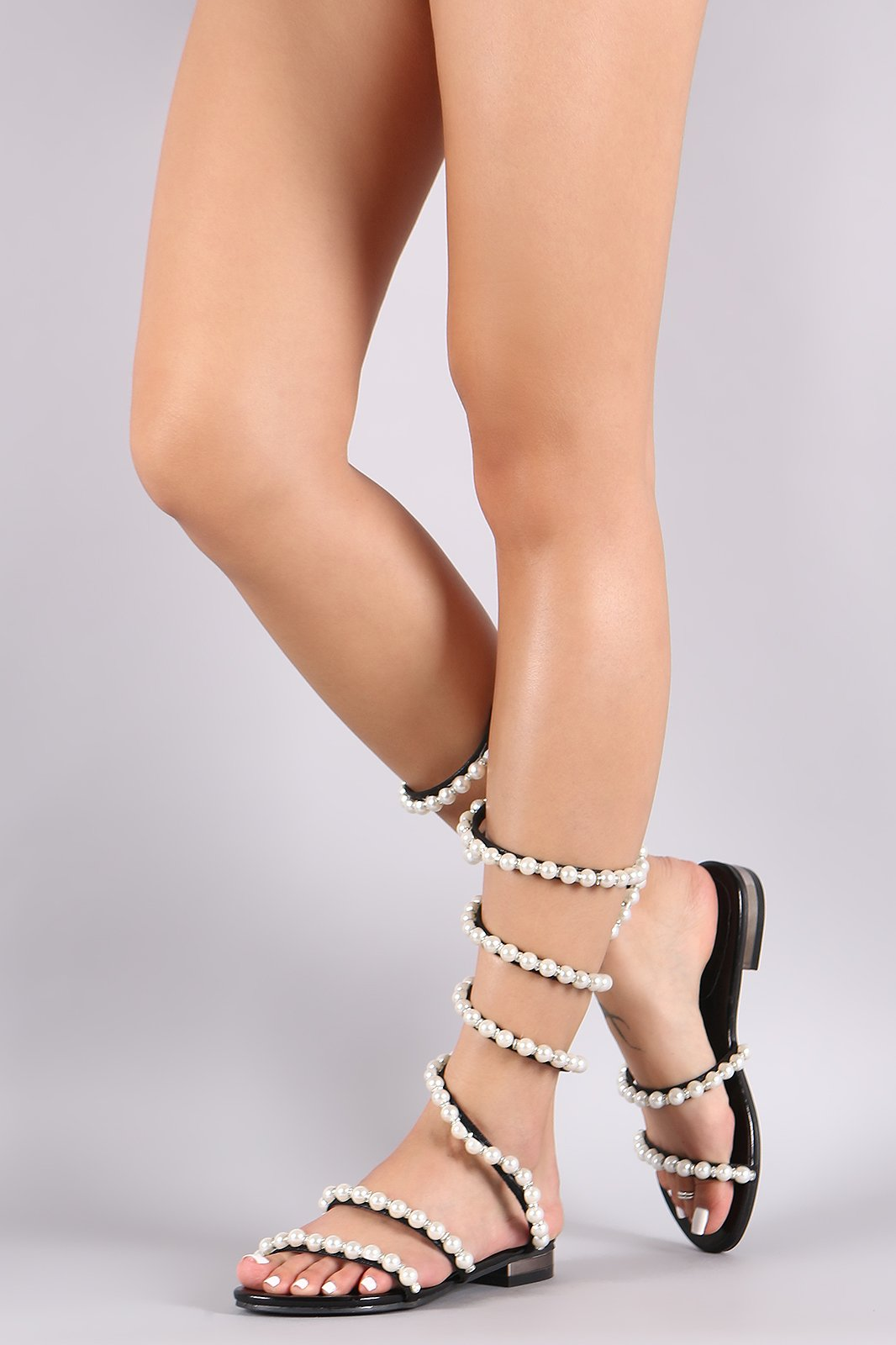 8ac95a72e950 This fabulous flat sandal features an open toe silhouette