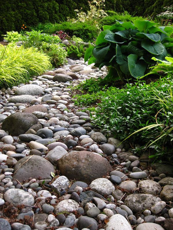 Dry Creek Bed.  To look natural a creek bed should consist of several different sized rocks (12 inches and bigger), some river rocks (7-8 inches), and some smaller pebbles (2-3 inches).