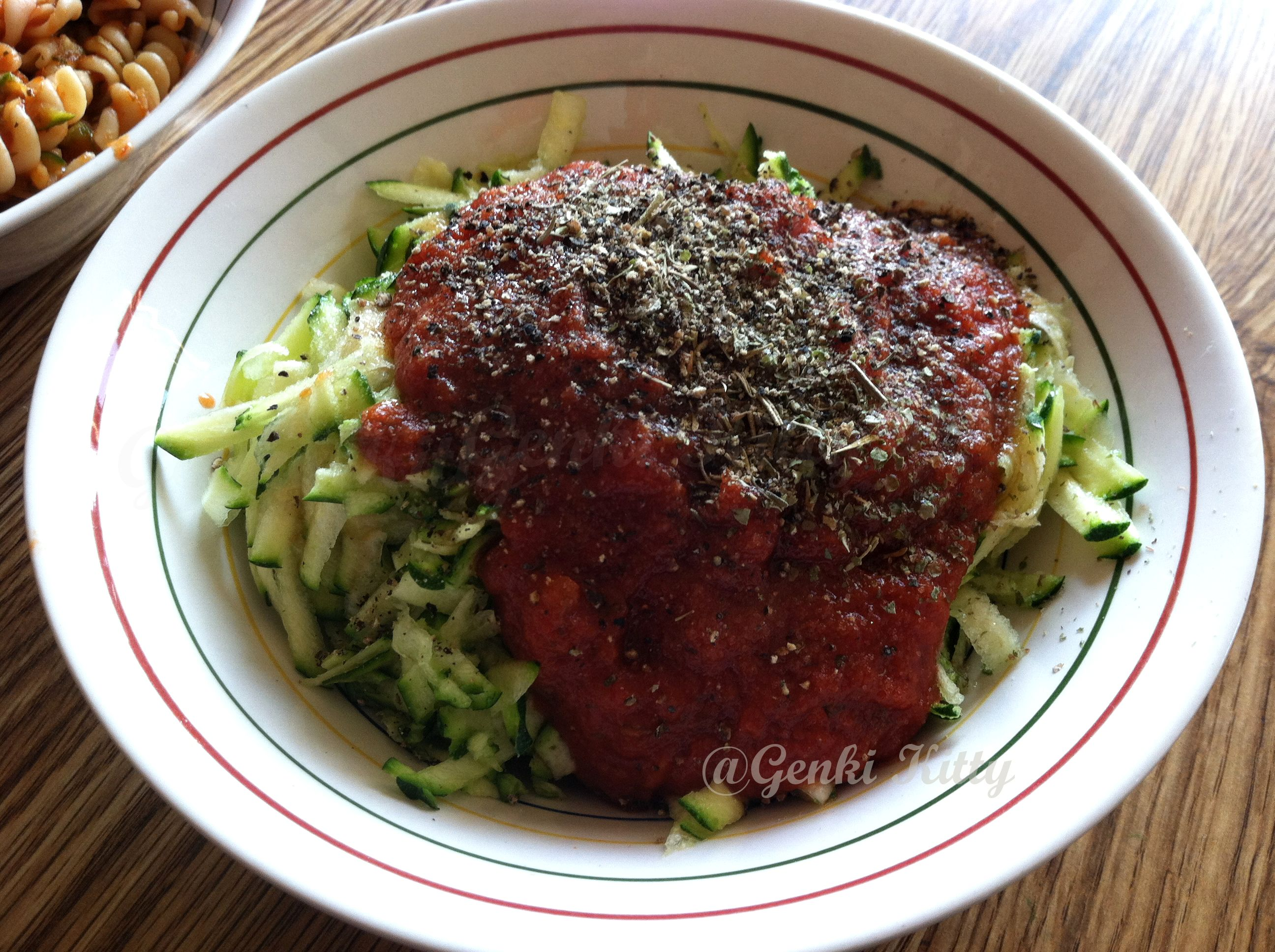 Zucchini noodles with tomato sauce on top.  #genkikitty #vegan #zucchini #noodle #pasta #healthy #recipe