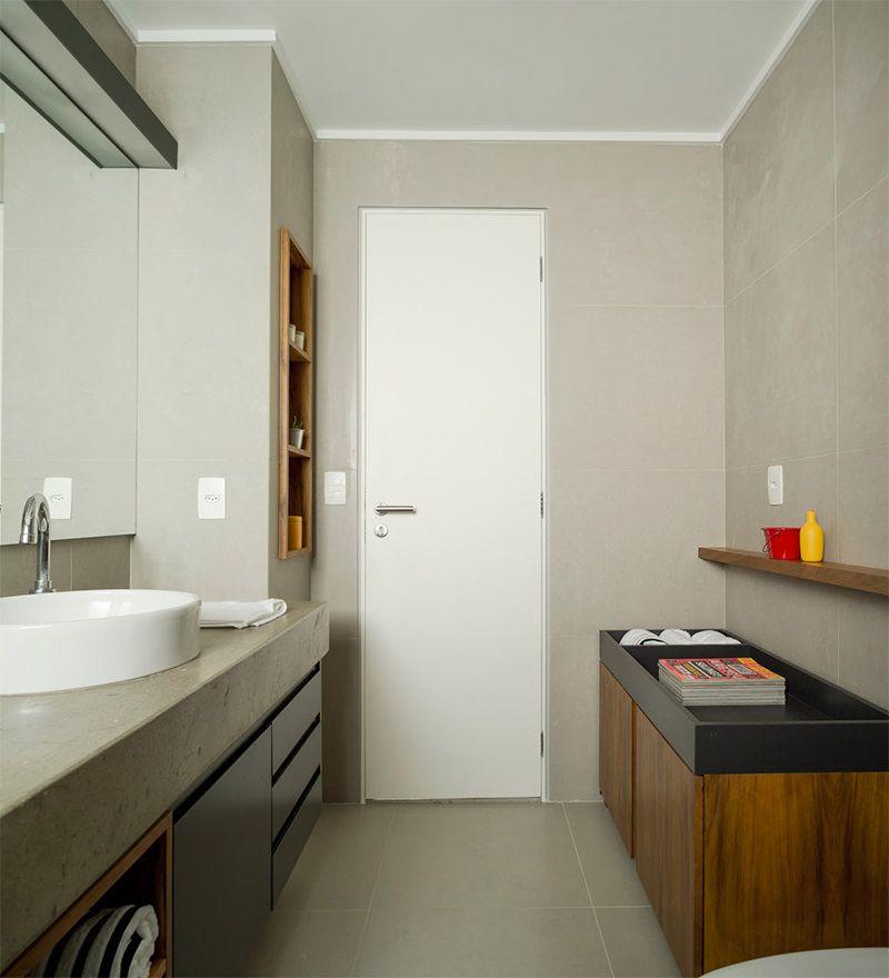 Um lindo apartamento com concreto aparente na decoração. DT Estúdio