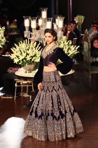 <3 Deepika Padukone in this gorgeous Manish Malhotra creation at the PCJ Delhi Couture Week 2013 - the raw silk choli is well tailored and those velvet puffy sleeves breakaway from the typical indian cholis