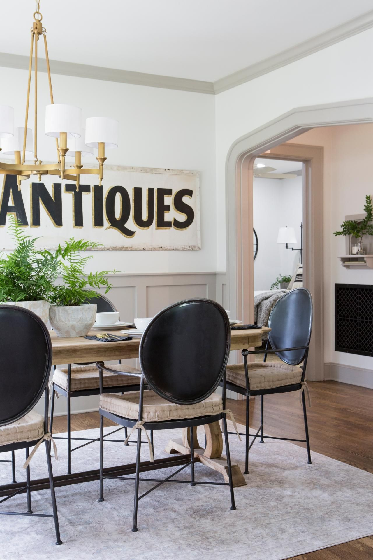 A Large Antiques Sign Stars As The Art In A Dining Room With