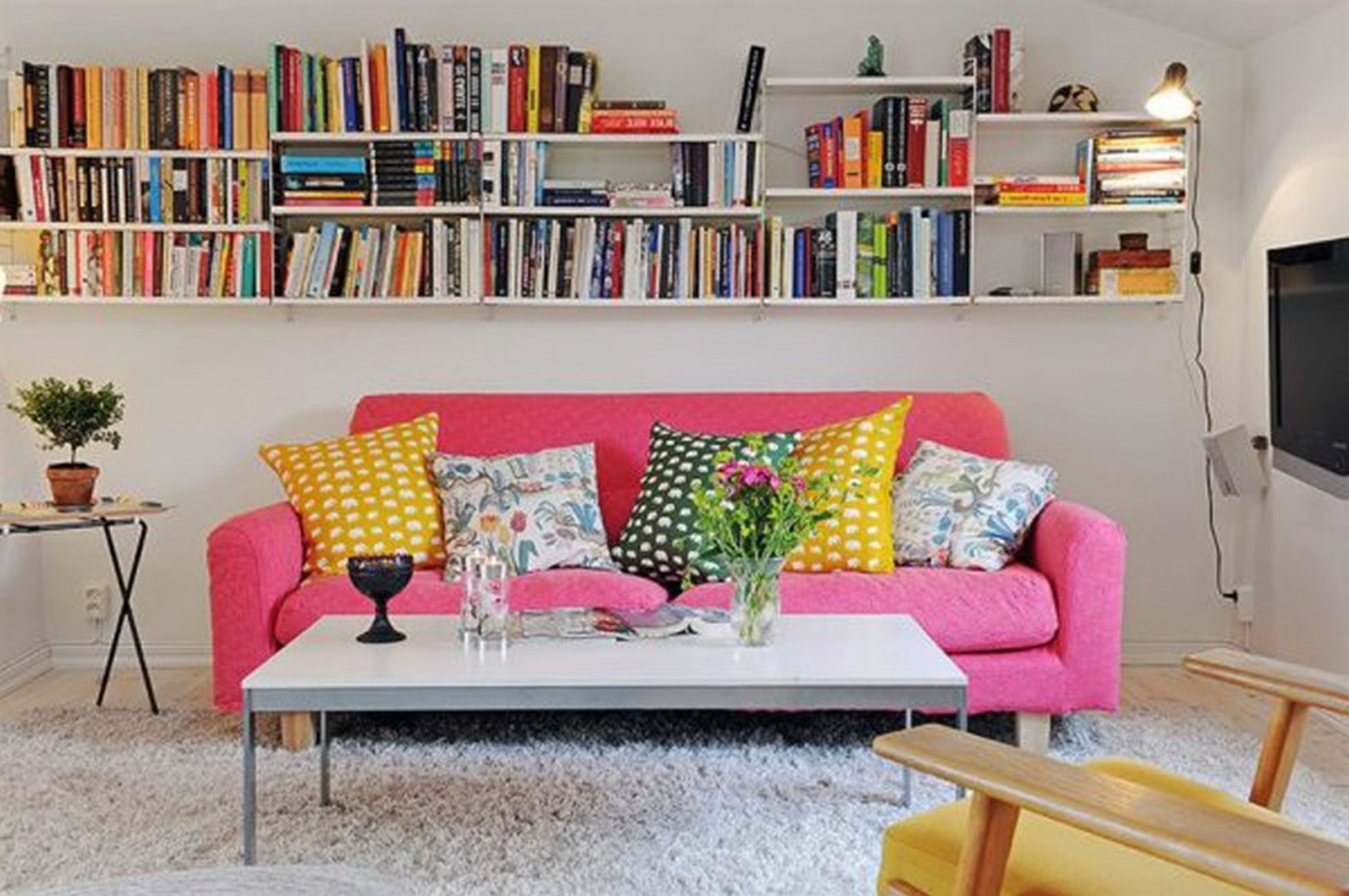 Pink Sofa White Shelves Living Room Eclectic Decor Home Designs. Very Small Apartment Ideas. Room Studio Interior Design Small Apartments Long Narrow Studio. How To Stay Safe Looking for No Fee Apartment Rentals in Nyc Nyc