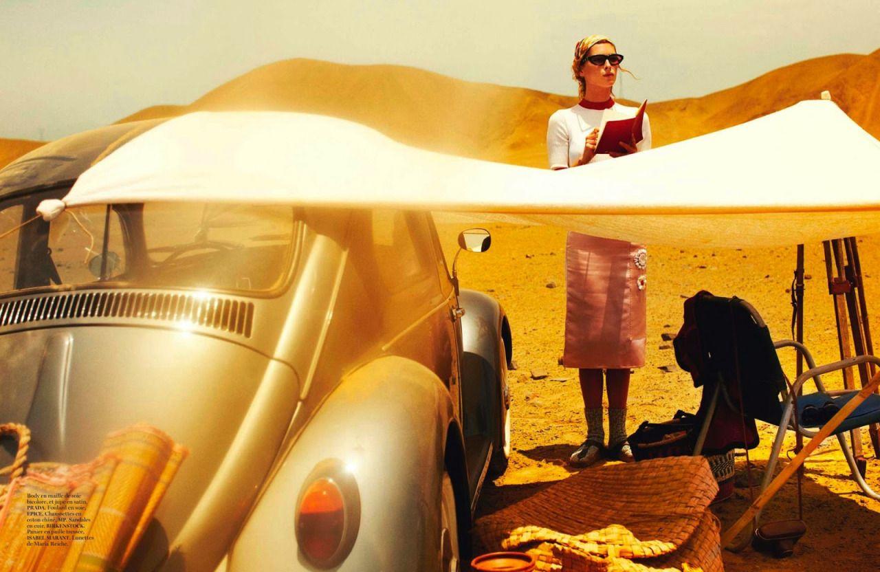 """Erin Wasson reading in """"Les Lignes de Nazca"""" for Vogue Paris, April 2013. Photographby Mario Testino.""""Body en maille de soie bicolore, et jupe en satin, PRADA. Foulard en soie, EPICE. Chaussettes en coton chiné, MP. Sandales en cuir, BIRKENSTOCK. Panier en paille tressée, ISABEL MARANT. Lunettes de Maria Reich."""""""