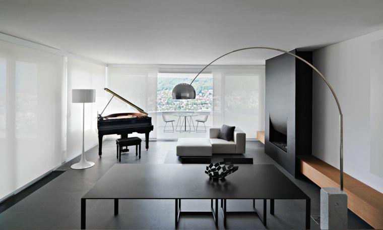 Pareti Con Foto In Bianco E Nero : Parete attrezzata con camino di colore nero con divano bianco e