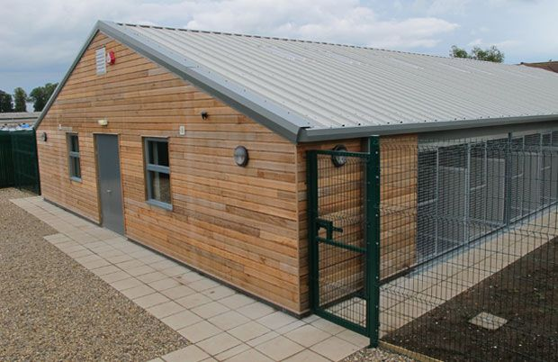 Kennel building design plans commercial kennels kennel for Dog boarding kennel designs
