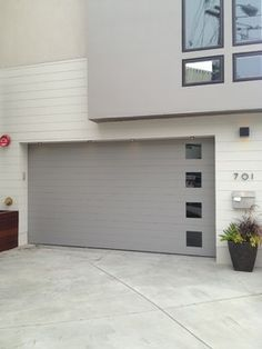 Carriage House Painted Garage Doors modern garage doors Puertas