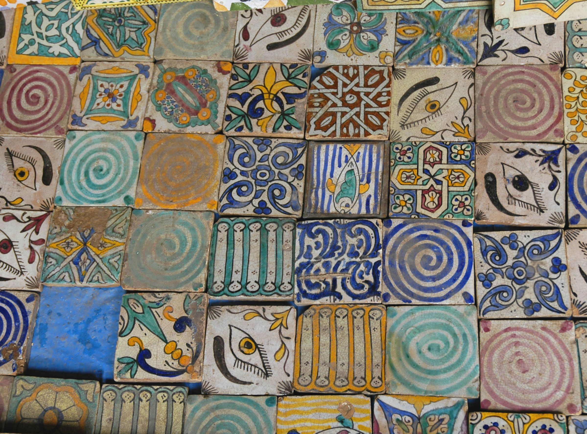 Hand painted ceramic tiles at a street market in marrakech hand painted ceramic tiles at a street market in marrakech morocco dailygadgetfo Choice Image