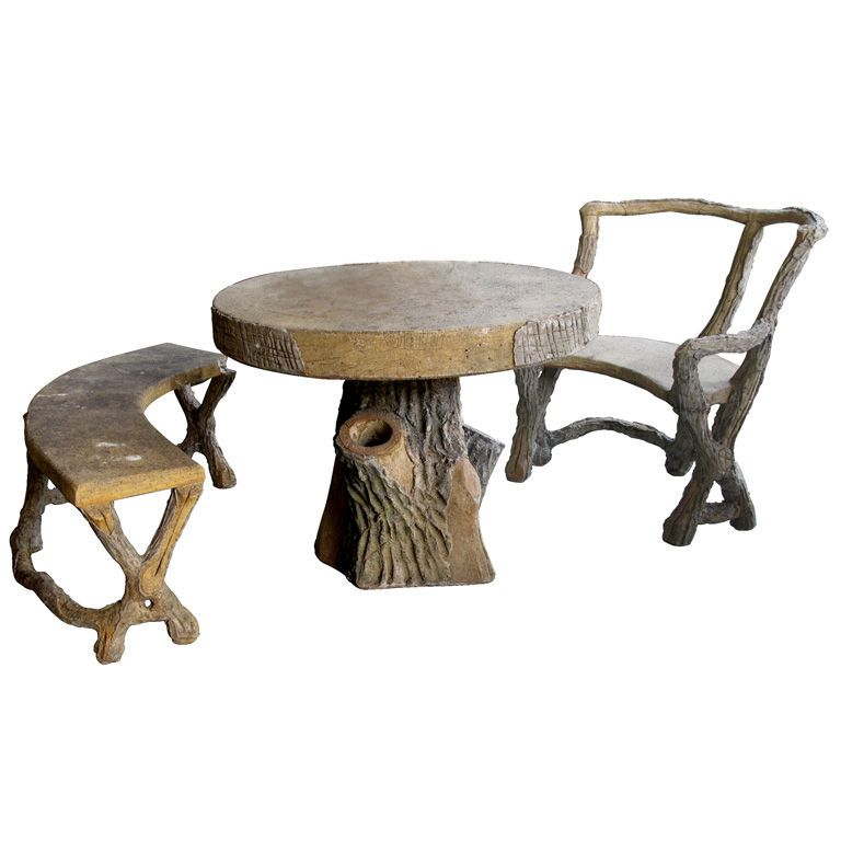 a fanciful 3 piece french faux bois concrete garden set with table bench and seat